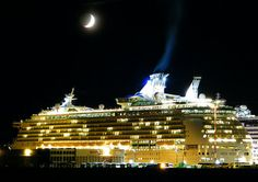 Mariner of the Seas lit up under the moonlight.