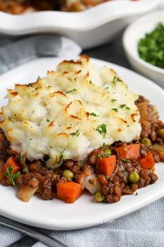 Vegetarian Shepherd's Pie has tender lentils simmered in a rich savory broth, topped with creamy mashed potatoes. This dish is baked to golden perfection for a meatless main dish for St. Patrick's day and beyond! #spendwithpennies #shepherdspie #lentils #vegetarian #vegetariancasserole #mashedpotatoes #meatlessmonday Tasty Vegetarian Recipes, Vegetarian Main Dishes, Veggie Recipes, Healthy Recipes, Easy Lentil Recipes, Vegetarian Recipes Lentils, Potato Recipes, Dessert Recipes, Mashed Potato Meals