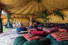 The Festival Wedding to End All Festival Weddings: Oasis Events Boutique tent with saffron linings and Chill-out furniture - Charlie & Kane's wedding via VivaWeddings and @Kat Williams