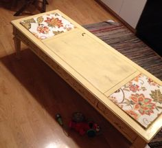 Please ignore the Elmo! This coffee table was painted with Rustolium Painters Touch 2x spray paint with fabric decoupage over the old marble inlay pieces. It was super ugly!