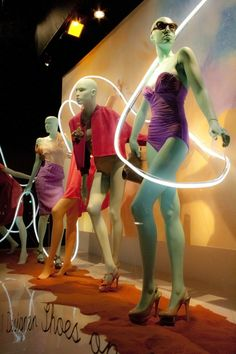 Awesome use of color! I love the pastels and the use of light running around the mannequins.  This gives the display direction from left to right following the light through all the outfits. Its also nice that the mannequins are in different positions creating different lines throughout the window.