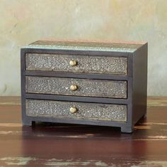 "RAJ JEWELRY CHEST -- Store your precious baubles beautifully in our three-drawer bureau, vibrantly topped in red and teal, elaborately adorned with antiqued white metal filigree. Imported. Catalog exclusive. 10""W x 6-1/2""D x 7""H."