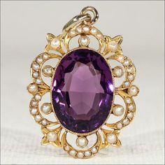 The pendant is set with 42 creamy half pearls with a pinkish undertone in the nacre. The amethyst is an oval faceted cut in a gorgeous scalloped frame.