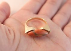 A personal favorite from my Etsy shop https://www.etsy.com/listing/463430246/howlite-salmon-ring-gold-statement-rings