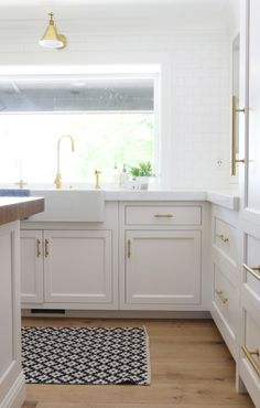 a kilim kitchen runner + brass fixtures Photography: Studio McGee - studio-mcgee.com   Read More on SMP: http://www.stylemepretty.com/living/2016/02/04/kitchen-dreaming-with-this-bright-classic-remodel/