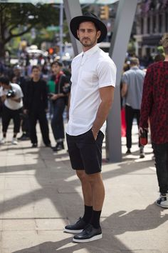 Shop this look on Lookastic:  http://lookastic.com/men/looks/hat-short-sleeve-shirt-shorts-bracelet-socks-derby-shoes/10022  — Black Wool Hat  — White Short Sleeve Shirt  — Black Shorts  — Silver Bracelet  — Black Socks  — Black and White Leather Derby Shoes