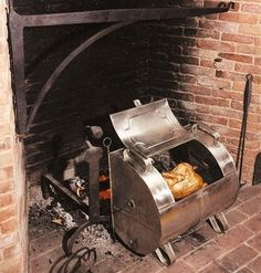 Early American Colonial Tin Reflector Oven - reproduction but a good idea.    **Update - the one pictured is a bit pricy at almost $500, but this link has the roaster and biscuit ovens for just over $100.  http://dixietinworks.com/kitchenware.html