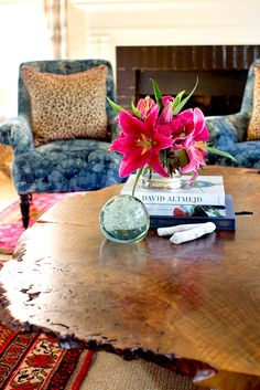Coffee table styled with books, flowers, and small trinket