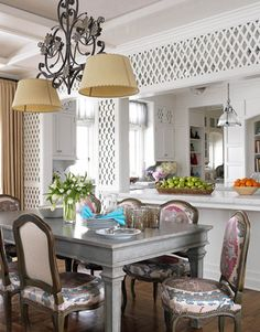 Just a Touch of Color To balance the diamond pattern on the walls, Allison Caccoma used softer lines and curves in this breakfast room's chandelier and chairs. The floral colors of the fabric, a Robert Kime suzani, provides a burst of color against the all-white kitchen and helps the space feel like an extension of the garden.