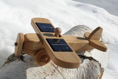 Solar powered wooden toy - Miles would love this!