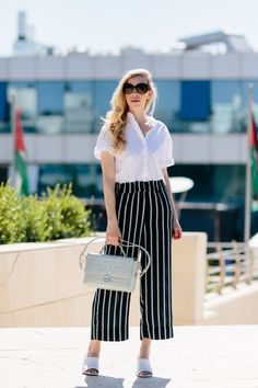 Striped Pants for Summer: white short sleeve cotton shirt with striped culotte pants, @brahmin 'Danielle' satchel and white mules, how to wear striped pants, striped culottes summer outfit To Shop, click here: http://rstyle.me/n/cni3zqbexsf