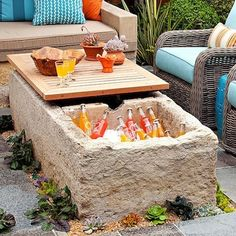 Coffee Table Cooler - Whether you have a wood deck, brick patio, or wrap-around porch, there's a solution out there for your individual storage needs. Here, limestone has been carved to create a roughhewn coffee table that doubles as a handy drinks cooler.
