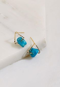 #ModCloth - #GE3389-2BL Your interpretation of these golden earrings is that they're meant to spiff up everyday ensembles all throughout the week! Starring textured triangles along which turquoise-inspired stones are strung, these unique posts put an inventive spin on your creat - AdoreWe.com