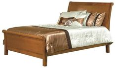 Amish Crescent Sleigh Bed Cozy and elegant. Grand and supportive. The Crescent Sleigh is custom made for your bedroom in choice of wood, stain and size.