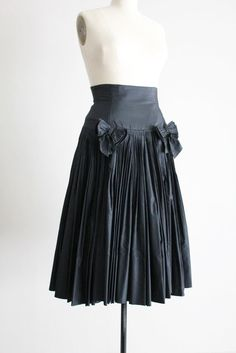 1950s couture skirt / black silk skirt / black bow skirt. $375.00, via allencompany.