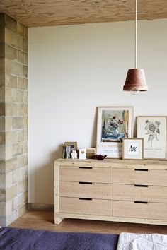 Detail from master bedroom. Chest of drawers by Mark Tuckey. 'Lovers' print by Rachel Castle. Photo -Sean Fennessy, production – Lucy Fe...
