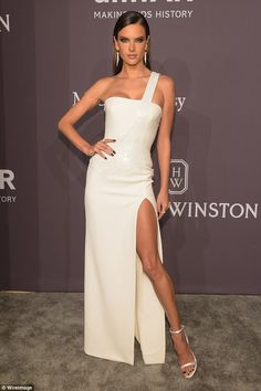 A bit of all white: Alessandra Ambrosio managed to stand out at the Annual amfAR New York Gala on Wednesday night