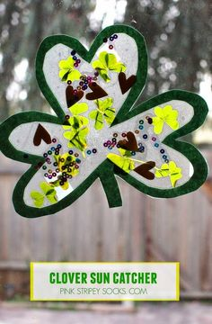 Here's a fun craft- Easy to make St. Patrick's Day Clover Sun Catchers