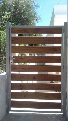 Custom wrought iron gate that keeps strangers away and for Portones de madera y hierro