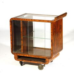 An Art Deco walnut bar trolly