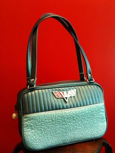Getting one of these custom made for me.  I predict that this purse will the prime of my collection!