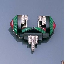 An art deco jade, onyx and ruby clip brooch, £5,000 - 6,000 US$ 8,300 - 10,000