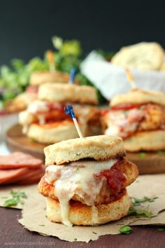 Chicken Pizziola Sliders on Garlic Herb Biscuits: perfect oven-fried chicken topped with pizza sauce, pepperoni and cheese and piled high on a flaky, homemade biscuit. It doesn't get better than this! www.thereciperebel.com