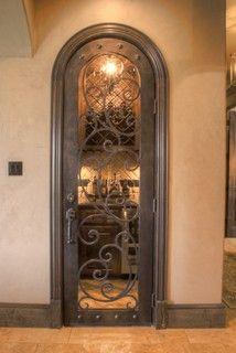Crenweldge house - mediterranean - kitchen - austin - by Curtis Cook Designs ~ What a neat looking door.