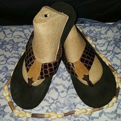 Cute brown n black flip flops Black flips flops w/brown crocodile looking uppers with a suede patch over the toe area. NWOT Size : 10M by: Corkus Corkus  Shoes Sandals