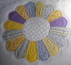 """Dresden quilt, made with antique blocks, quilted by Prairie Moon Quilts: """"I decided... to make each plate look like a great big flower. I first quilted about 1/4″ inside each blade, then did a smaller petal inside the bigger one, then did a squiggle up through the middle of each one. I outlined the entire outer edge of the plate, then outlined again 1/4″ outside that."""""""