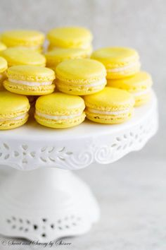 Lemon French Macarons- perfect spring-flavored confections with zesty lemon buttercream that you can make right at home with my new video tutorial!  ~ Sweet and Savory by Shinee