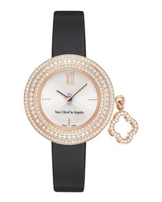 Charms mini watch by Van Cleef & Arpels. 18-karat pink gold case, 25mm. Bezel set with three rows of round diamonds. Rotating charm with round diamonds. Cream lacquer dial with Alhambra motif. Black a