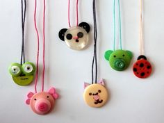 button crafts animal necklace  Would be cute to make for hair clips perhaps?
