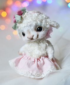 Hello! This is my new OOAK lamb - Rozemary. I sewed her from the German viscose and japan silk. She is 12 cm high. She is stuffed firmly with polyester and metal pellets. Face made from wool. She toned oil paints. She is fully jointed, 6 way jointed, double jointed neck. Lamb has black glass eyes. She can move her arms, legs and head. Hat and skirt can be removed.