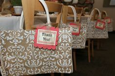 party favors - just saw some really cute black and white (damask style) bags at the Dollar Tree...could fill them with treats or a magazine or something...love the idea of putting them on chairs)