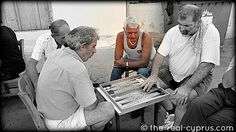 http://www.the-real-cyprus.com  - Not only are the cards out but the Tavli (backgammon) is out as well...