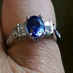 Sapphire and diamond 14k white gold ring size 6.5 Stunning custom made Sapphire oval center stone with princess cut diamonds.  Total Carat weight 2.8 carats!  Size 6.5 only worn 4 or 5 times..like new! Jewelry Rings