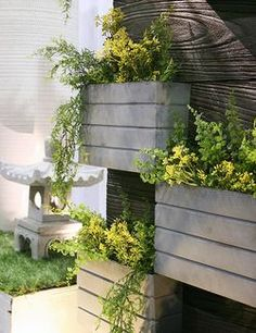 Eco friendly garden containers Compo Clay - A concrete type material takes on the look of wood w/o the rot. ( :