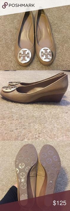 Tory Burch wedge (1.5 inch wedge heel) This Tory Burch wedge is patent tan with a gold emblem. It has a small heel so you can have comfort all day long. Never worn, will go with any outfit all year long. I am usually in between a 5.5 and 5 but a 5 for me in this shoe. Tory Burch Shoes Wedges