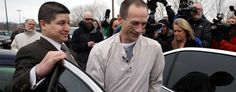 Sergio Serritella, left, a private investigator, guides Christopher Abernathy into a waiting car after he was released from the Stateville Correctional Center in Crest Hill, Ill. (AP)