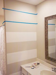 LiveLoveDIY: Striped Wall Tutorial. Could do on two end walls in bathroom