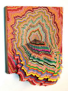 I'm loving Jen Stark. The really bright colors and concentric shapes remind me of drawings I once saw in a psychology book that were done by schizophrenic people.