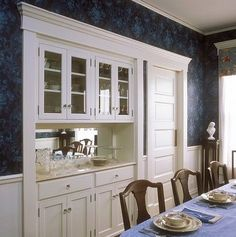 Stock Photo STORAGE A Built In China Cabinet And Buffet Restored Victorian Dining Room All Wood Is Painted White Dark Blue Patterned Wallpaper