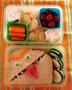 Lunch - Sandwich with cucumber, carrots, grapes, Tortilla chips instead of chips & add 2 salsas or add 2 mini cupcakes