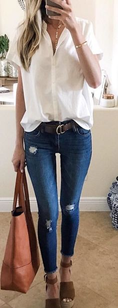 bc9fd882af05  spring  outfits woman in white button-up shirt and blue jeans. Pic