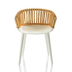 Design by Marcel Wanders, 2011. Made in Italy by Magis. $820. Two unexpected materials come together in the Cyborg Club Armchair: a wicker cane seat back meets its molded polycarbonate counterpart in the chair's base. The front edge of the polycarbonate seat curves downward, taking pressure off the back of the legs and making this chair comfortable for the long haul. The low circular back, offering built-in armrests, is wrapped with wicker cane in a vertical pattern. Available in two colors.