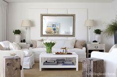Suzie: New England Home - Beachy living room design with limed gray oak rectangular mirror, ...