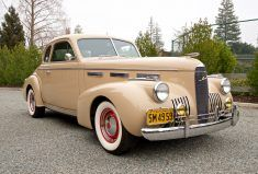 This 1949 FrazerVagabond looks to be a very nice example of one of the world's first hatchbacks. The wood-slatted tailgate and cargo area is a wonderful sight, and the Bakelite steering wheel, three-speed column shifter, and light blue over red color combo are nice as well. Find it here on Cra
