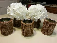 Rope-wrapped soup cans as easy, DIY vases