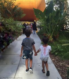 Too cute: North West and cousin Mason Disick were seen holding hands in a sweet Instagram photo shared by Kourtney Kardashian on Monday